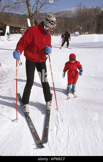 Vermont Bolton Valley Ski Resort winter sports father child learning balance - Stock Image