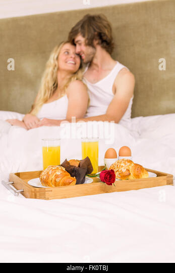 Cute couple having breakfast in bed - Stock-Bilder