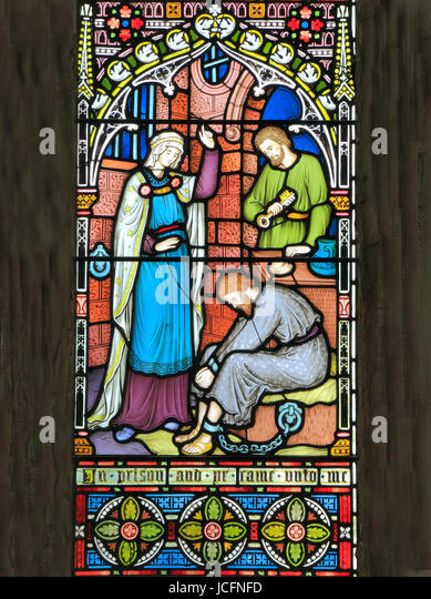 Corporal Acts of Mercy window, visiting the imprisoned, stained glass by Frederick Preedy, 1868, Gunthorpe, Norfolk - Stock Image