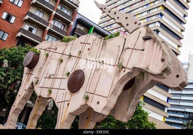Johannesburg South Africa African artist Clive van den Berg Eland statue Gateway Braamfontein concrete large giant - Stock Image