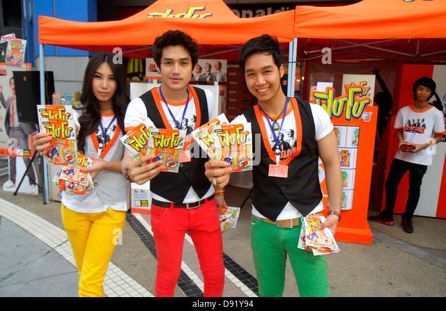 Bangkok Thailand Pathum Wan Rama 1 Road MBK Center centre Asian man woman product promotion WuFu free sample booth - Stock Image