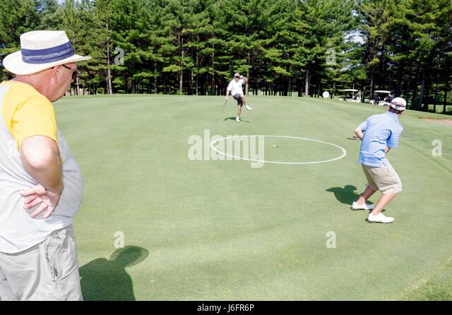 Wisconsin Kenosha Kansasville Brighton Dale Links golf course county park system man men senior boy teen practice - Stock Image