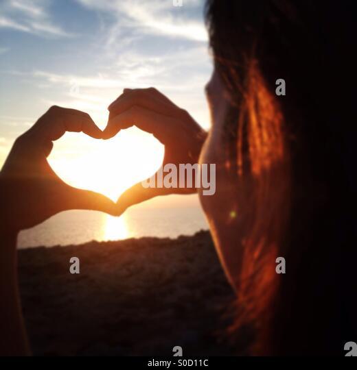 Watching the sunset menorca - Stock Image