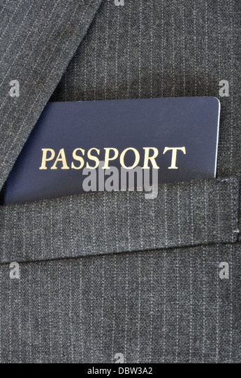 US passport in a suit coat top pocket - business travel concept - Stock-Bilder