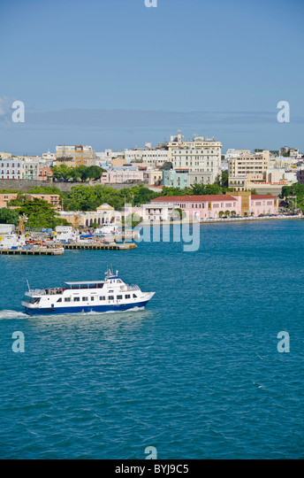 Puerto Rico Passenger ferry boat with Old San Juan as the background - Stock Image