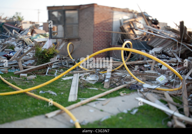 Debris surrounding homes destroyed by tornado in Tuscaloosa, Alabama. - Stock Image