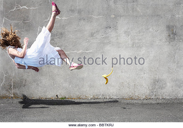 Girl slipping on a banana - Stock-Bilder