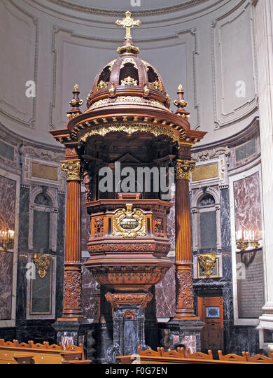 Pulpit in the Berlin Cathedral Pulpit c1905, Germany; Wood and gold design with crucifix. - Stock Image