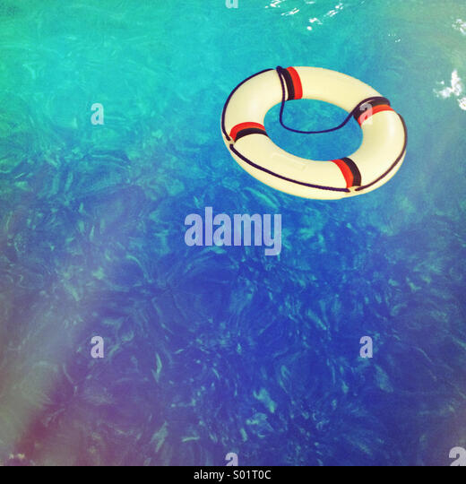 Life buoy in swimming pool - Stock Image