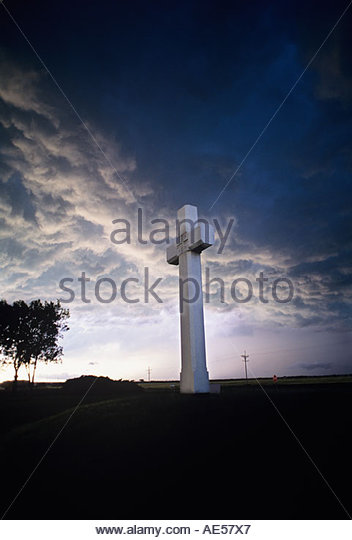 Very Large Christian Religious Cross along Kansas Highway 56 in the middle of crops fields roadside attraction USA - Stock Image