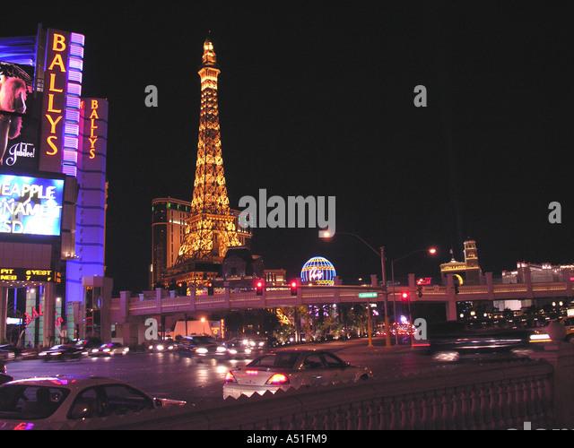 Eiffel Tower Paris Hotel Las Vegas strip skyline at night bright neon lights landmark building architecture - Stock Image