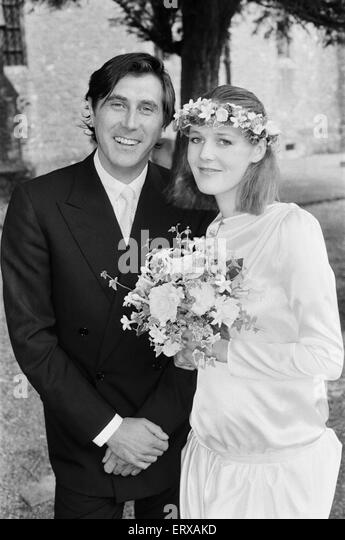 Pop star Bryan Ferry poses with his bride Lucy Helmore after thier wedding ceremony at St Anony's Roman Catholic - Stock Image