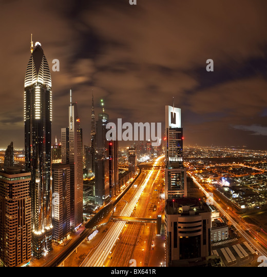Elevated view over the modern Skyscrapers along Sheikh Zayed Road looking towards the Burj Kalifa, Dubai, UAE - Stock Image