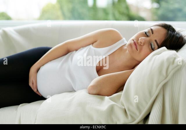 Pregnant woman sleeping - Stock Image