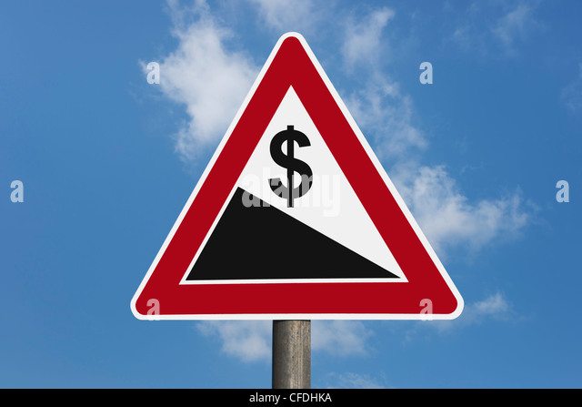 Detail photo of a danger sign 'Steep hill downwards' with a U.S. Dollar currency sign, background sky. - Stock Image