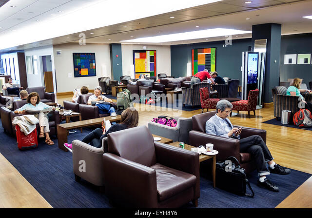 New York Queens John F. Kennedy International Airport JFK inside interior terminal concourse gate area British Airways - Stock Image
