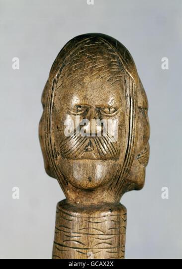 fine arts, Alpine folk art, scarving, wood, stylises head, top of a bat handle, 19th century, - Stock Image