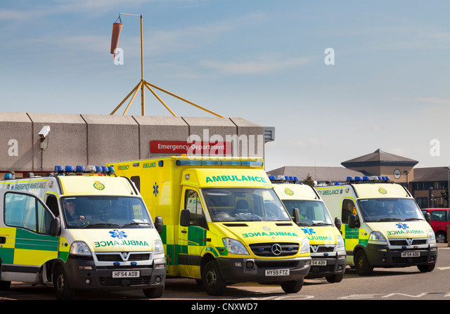Emergency ambulances parked outside accident and emergency department of Royal Bournemouth Hospital. - Stock Image