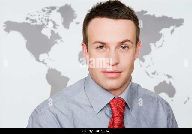 Office worker and world map - Stock Image