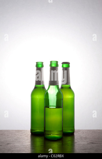 Beer bottles, half full - Stock Image
