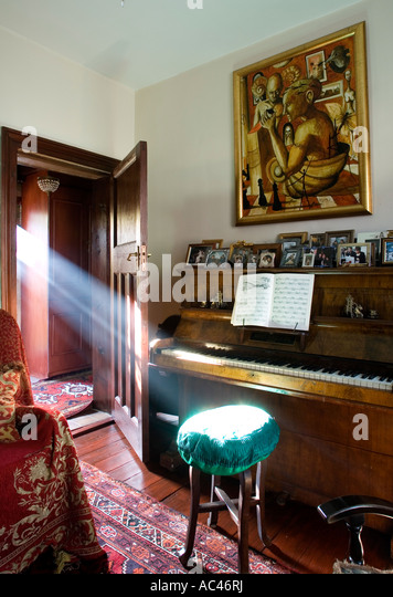 Ray of sunlight falls directly onto a piano school - Stock Image