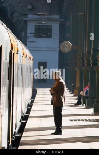 sao bento train station man standing waiting porto portugal - Stock Image