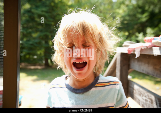 Young boy crying - Stock-Bilder