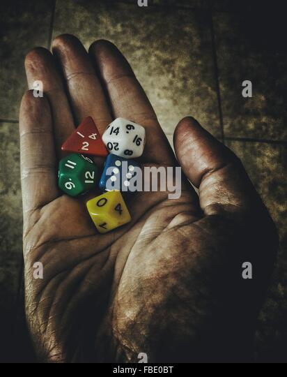 Cropped Hand Holding Various Dice - Stock Image