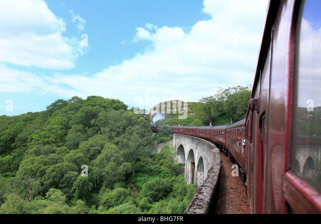 Steam train on glenfinnan viaduct - Stock Image