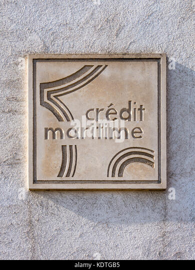 Credit Maritime stone plaque, La Rochelle, France. - Stock Image
