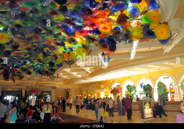 Nevada Las Vegas The Strip South Las Vegas Boulevard Bellagio hotel casino lobby ceiling glass Chihuly guests - Stock Image