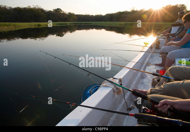 People fishing at Lake Kariba, near Binga, Midlands Province, Zimbabwe - Stock Image