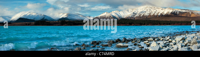 The snow-covered peaks of Mt Dobson stand as a backdrop to the turquoise waters of Lake Tekapo in Mackenzie Country, - Stock Image