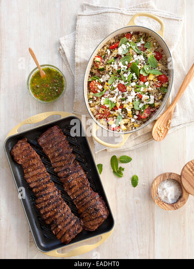 Grilled skirt steak and couscous on table - Stock Image