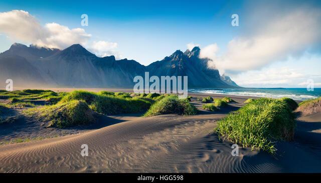 Black sand dunes on the Stokksnes headland on southeastern Icelandic coast. Colorful evening landscape in the Iceland, - Stock Image