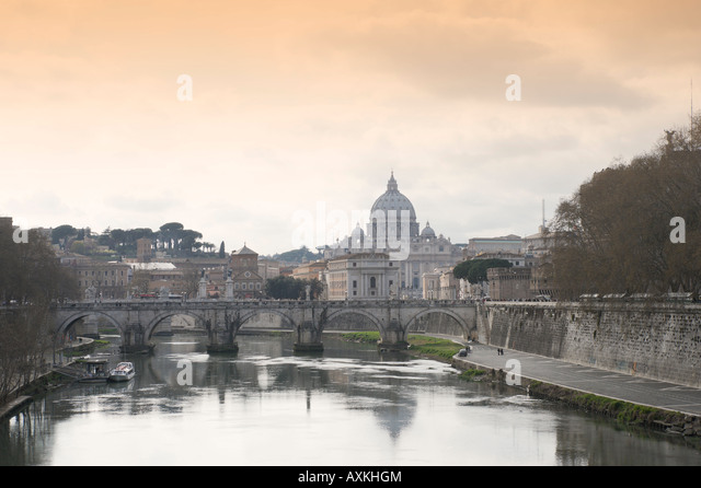 River Tiber, Ponte Sant Angelo and St Peter's Basilica, Historic Centre, Rome, Italy - Stock Image