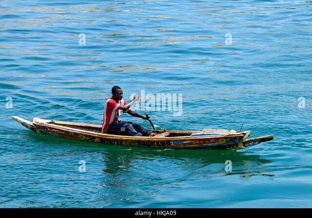 Rowing fisherman in canoe, Senegal - Stock Image
