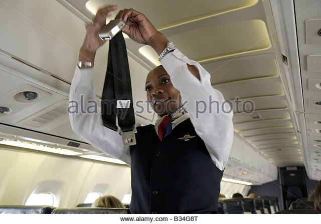 Georgia Atlanta Hartsfield International Airport Delta Airlines Black woman airline flight attendant aircraft safety - Stock Image