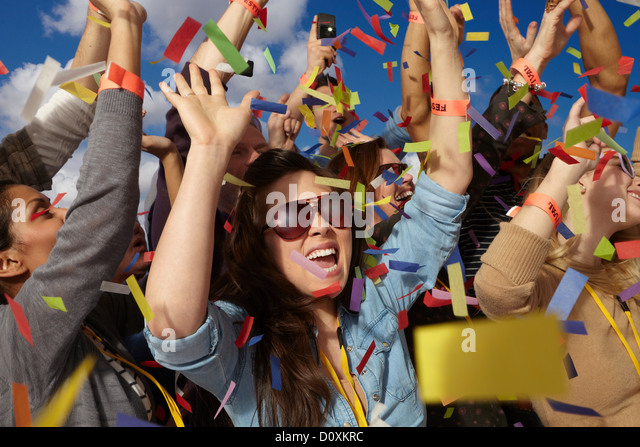 People cheering at a music festival - Stock-Bilder