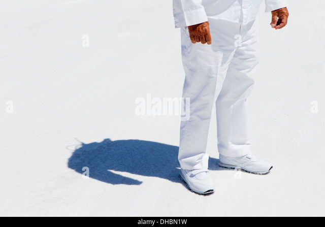A man in white overalls, a race official timekeeper at a car racing event,  at Speed Week on Bonneville Salt Flats. - Stock Image