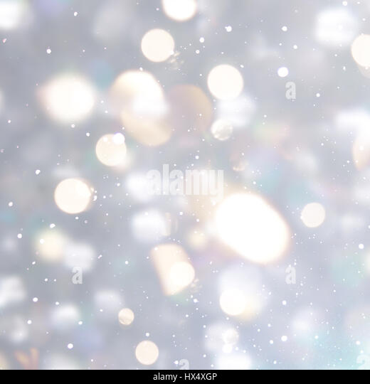 Silver Christmas background with bokeh lights - Stock Image