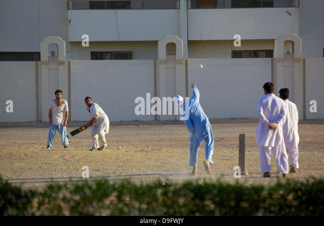 Local cricket match, Al Ain, Abu Dhabi, United Arab Emirates, Middle East - Stock Image