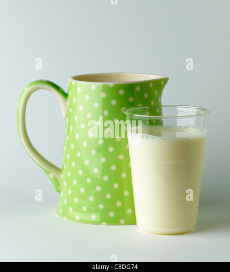 Jug and glass of milk - Stock Image