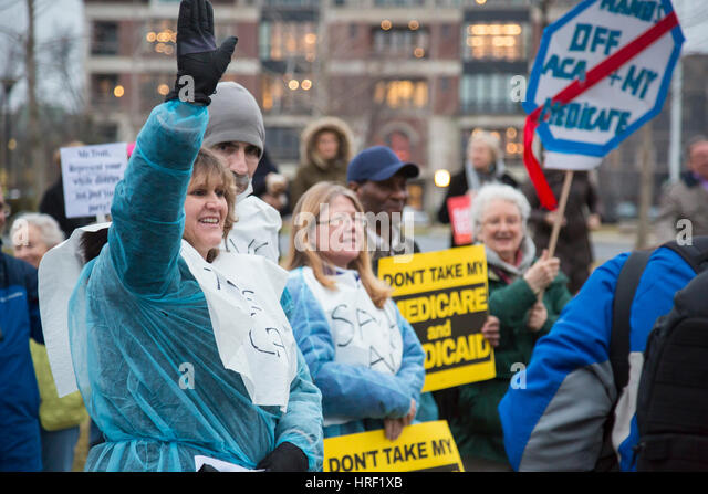 Birmingham, Michigan - With some wearing hospital gowns, people rally to save affordable health care. They were - Stock Image