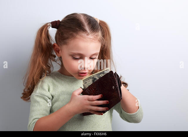 Cute surprising small kid girl looking in mother wallet and want to take money with empty copy space - Stock-Bilder