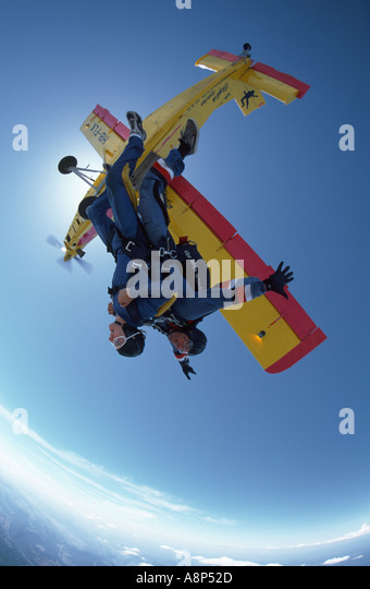 Tandem instructor taking a women for her first Skydive - Stock Image