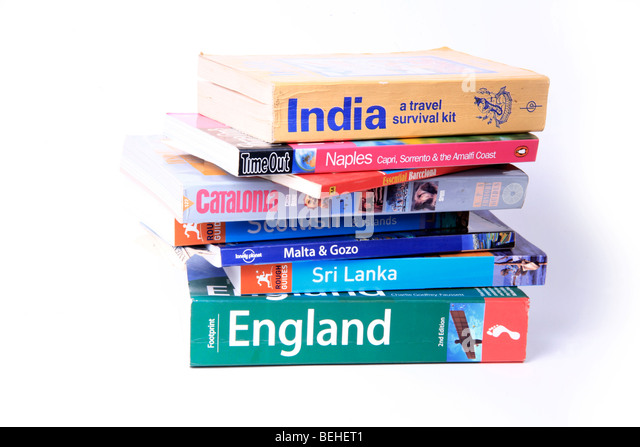 Pile of Destination Guides and Travel Books - Stock-Bilder