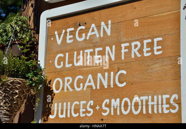 Organic vegan cafe sign - Stock Image