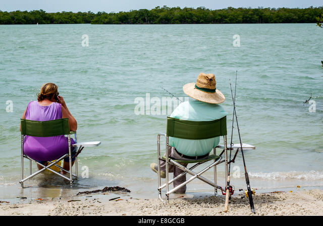 Fort Myers Florida Ft. Beach Long Key Gulf of Mexico Lover's Key State Park New Pass Estero Bay man woman couple - Stock Image