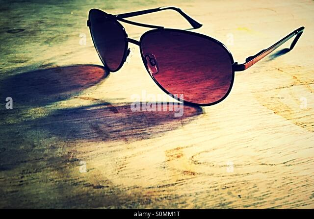 Sunglasses on a wooden table - Stock-Bilder